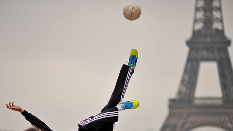 Interesting and unique photo of the Eiffel Tower, Adidas were filming an advert with DSLR cameras and footballers playing with balls