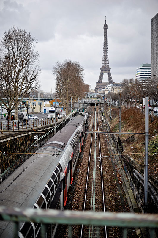 Watching a train arrive into Paris with the Eiffel Tower in the Background