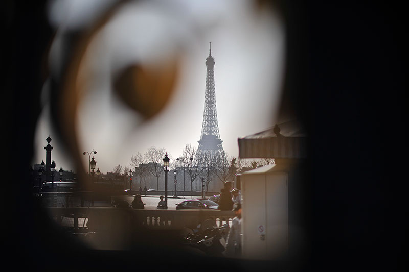 Through a gate, of the Eiffel Tower, Bokeh