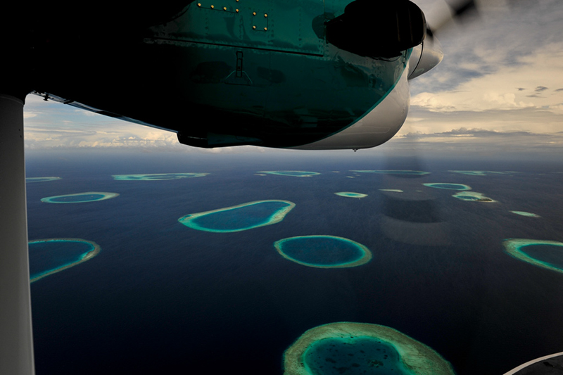Aerial view over a number of allots in the southern part of the Maldives Archipelago.
